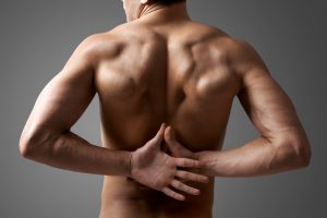 Rugpijn, sportmassage, stevige massage